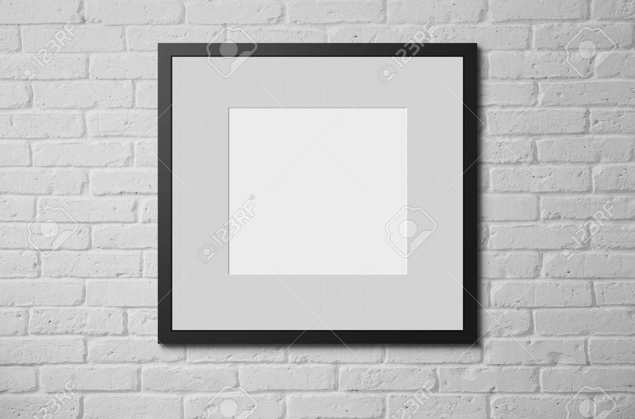 Blank picture frame at the brick wall with copy space and clipping path for the inside - 30891485