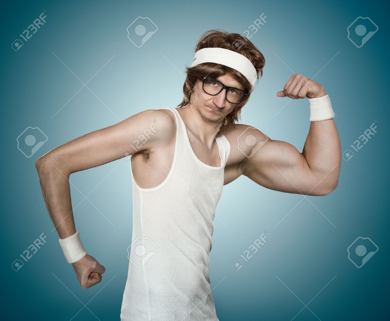 Funny retro nerd with one huge arm flexing his muscle over blue background - 31858852