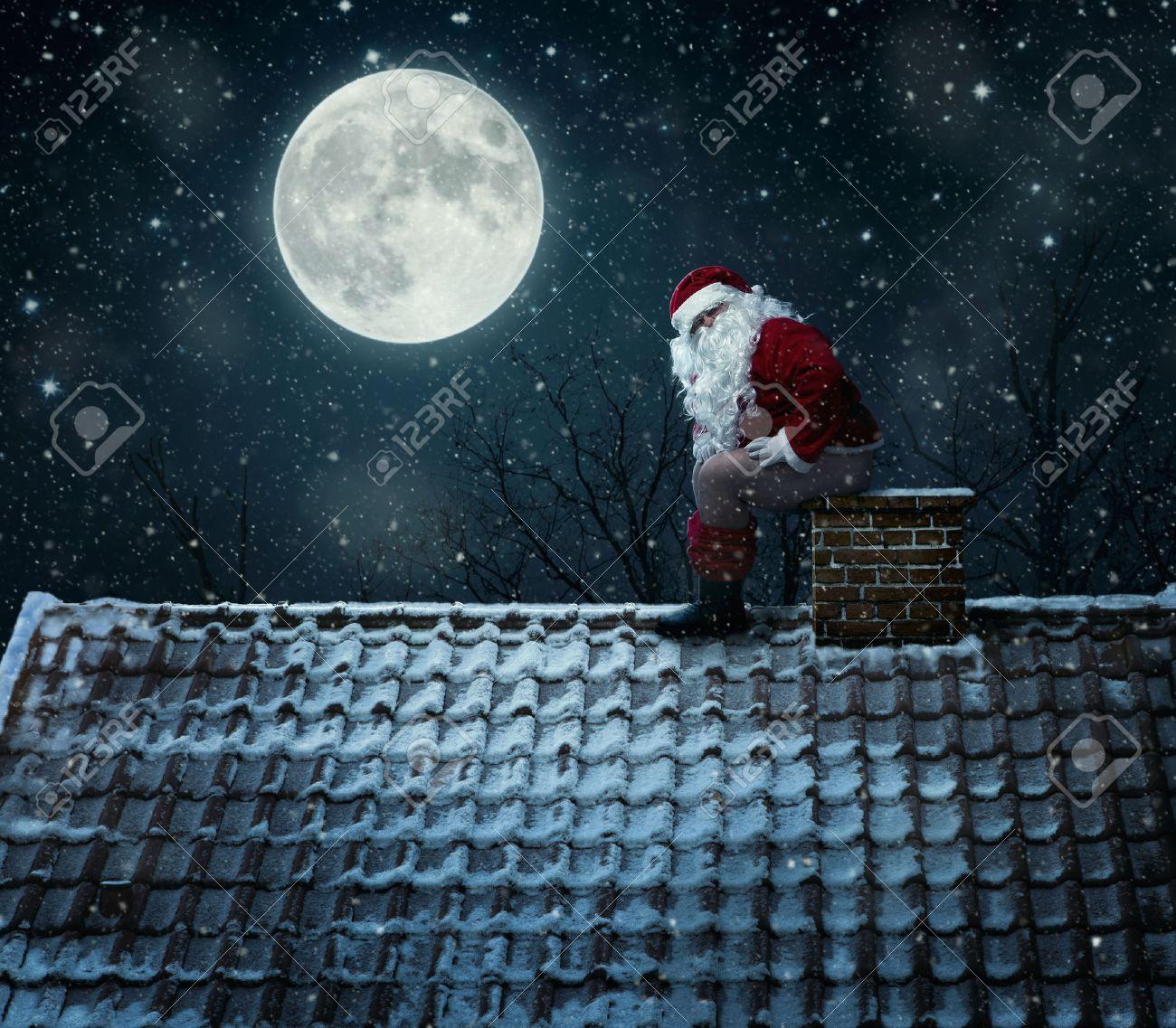 close up of mean santa using chimney as a toilet stock photo