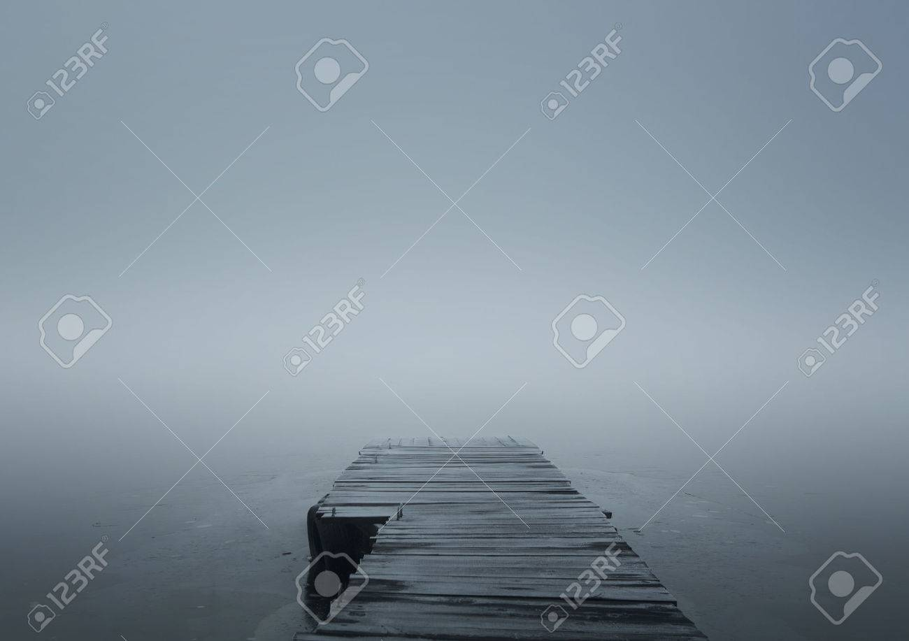 Close up of wooden jetty in the winter fog with copy space - 35852733