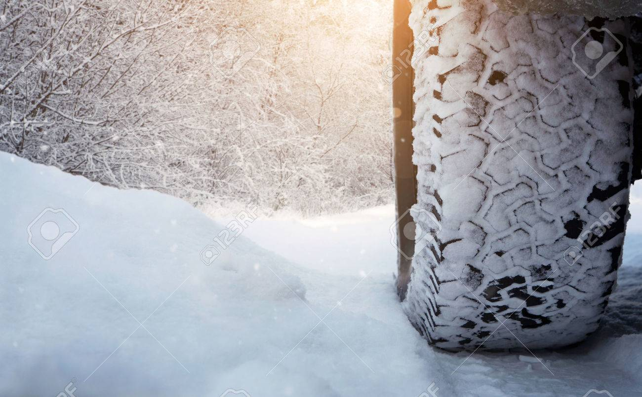 Close up of car tire on the snowy road with copy space Standard-Bild - 36438592