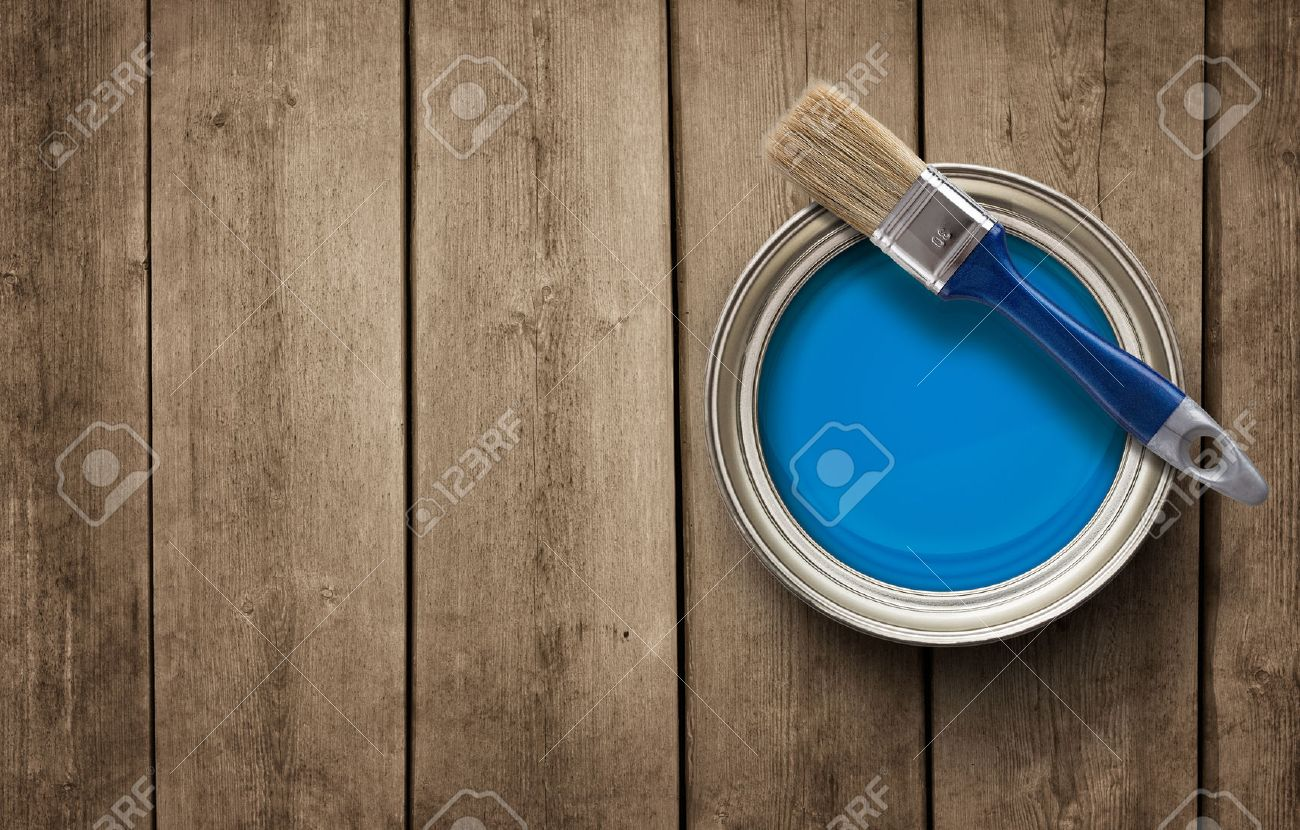 Paint can on the grunge wooden background with copy space - 39373621