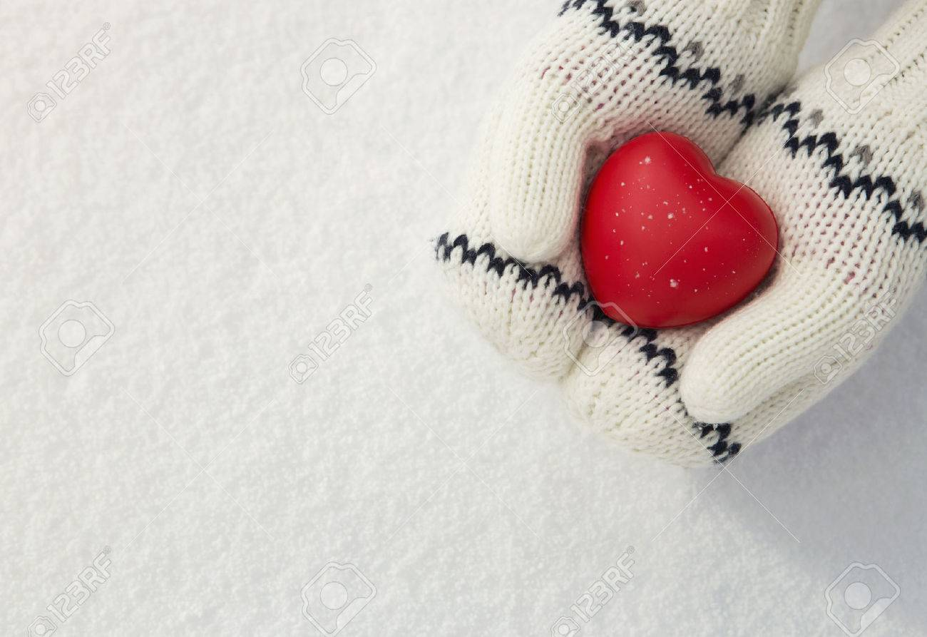 Winter , close up of little girls hands holding red rubber heart with copy space Standard-Bild - 39940785