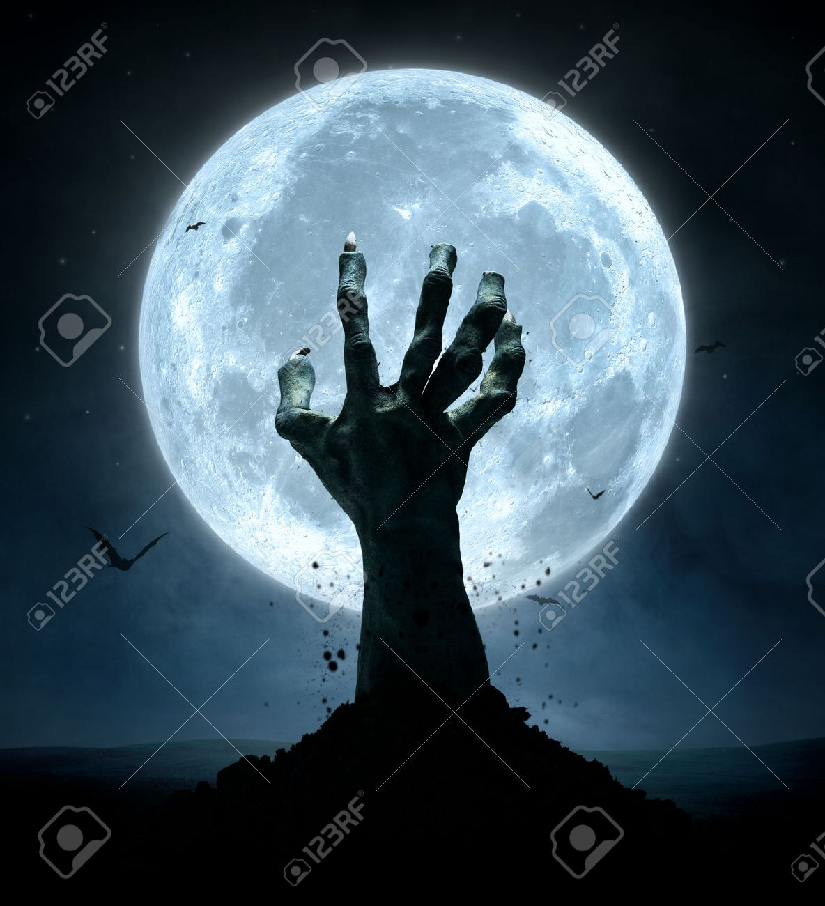 Halloween concept, zombie hand coming out from the grave Standard-Bild - 45167177