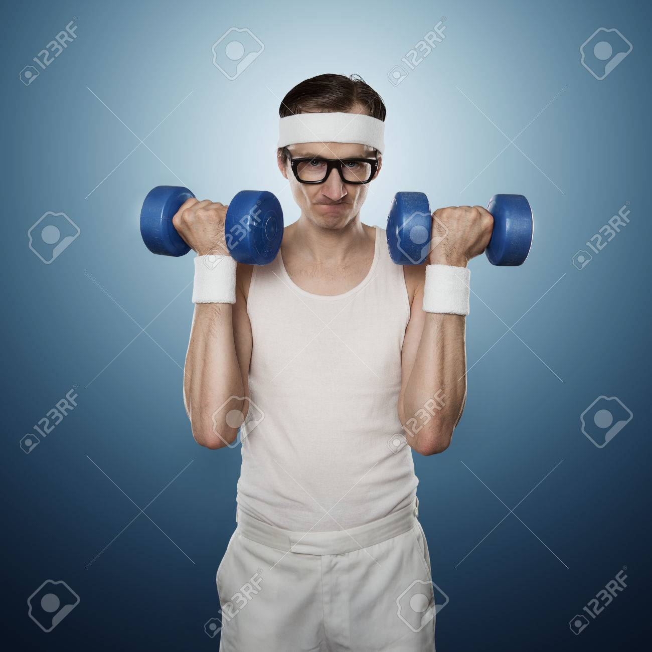 Funny sport nerd lifting weights isolated on blue background Standard-Bild - 47395962