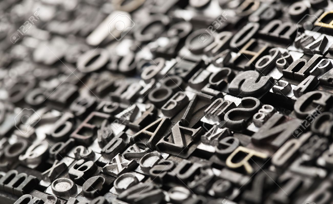 Letterpress background, close up of many old, random metal letters with copy space Standard-Bild - 49101246