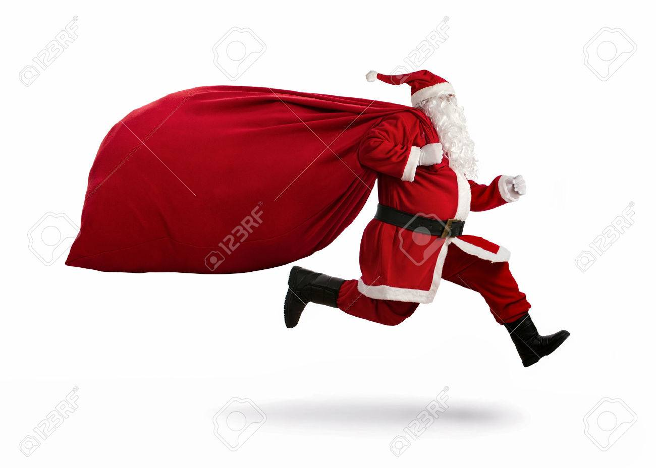 Santa Claus on the run to delivery christmas gifts isolated on white background Standard-Bild - 50754802