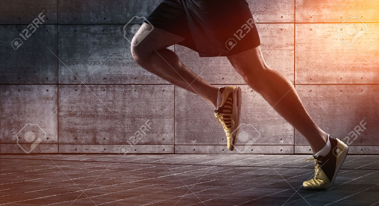 Sport background, close up of urban runner's legs run on the street with copy space - 55393237
