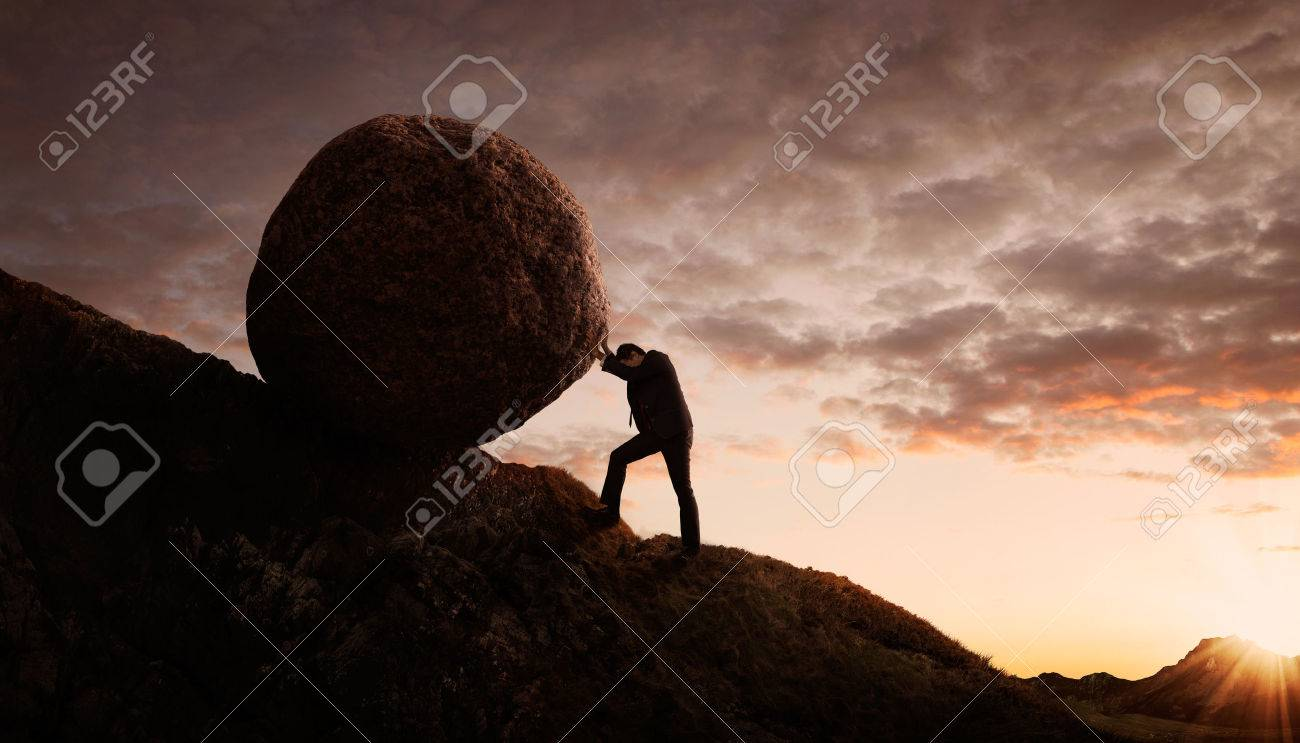 Business concept, Young businessman pushing large stone uphill with copy space Standard-Bild - 59789900