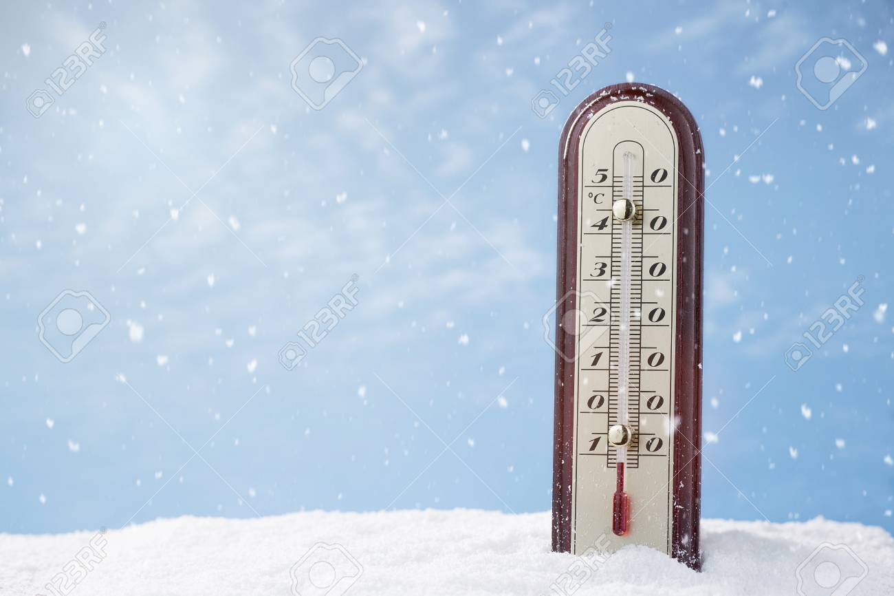 Close up of a thermometer in the snow with copy space - 66354096