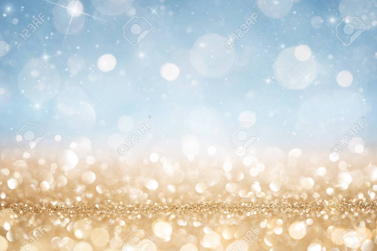 Abstract defocused gold and blue glitter background with copy space - 134335649