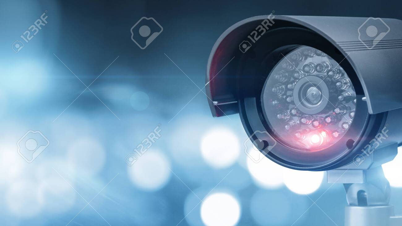 Close up of CCTV camera over defocused background with copy space - 142869537