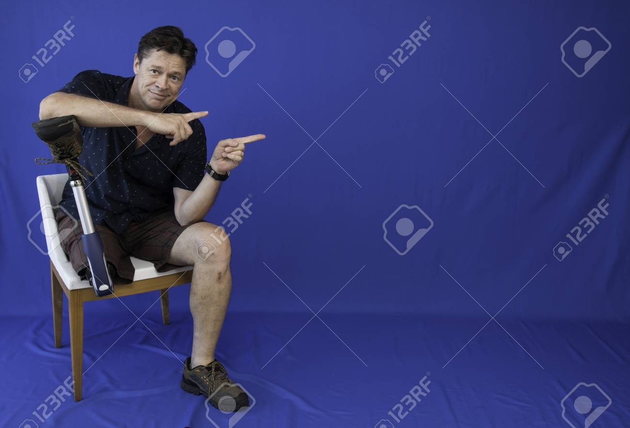 Middle-aged man with physical disability, happy with life sitting on the chair - 95536294