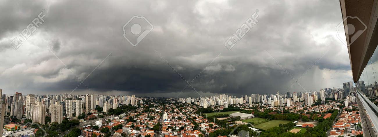 Cumulus nimbus cloud in the city. - 167085558