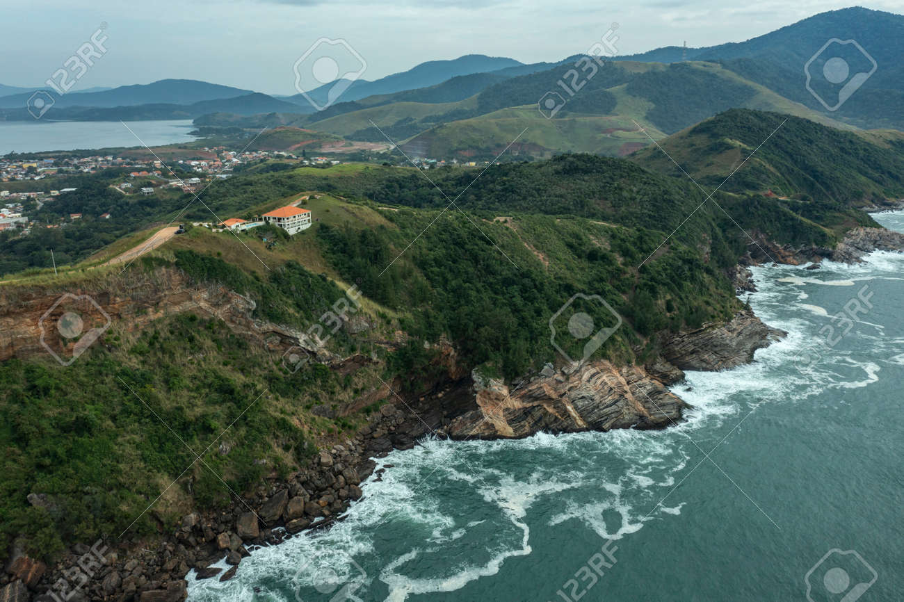 Sea and rocks. Aerial view of sea waves and fantastic Rocky coast. - 169727488