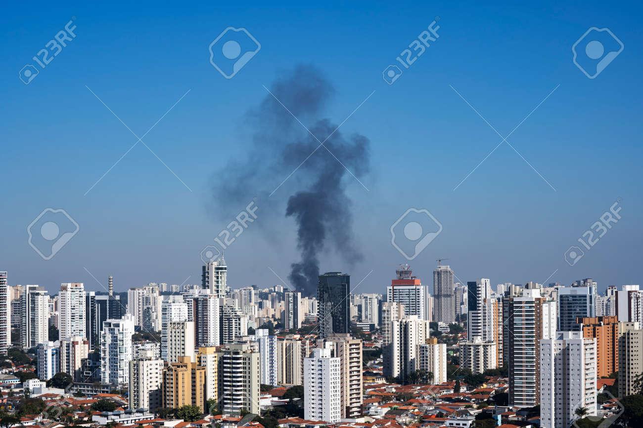 Black smoke in a city. Sao Paulo Brazil. - 172253948