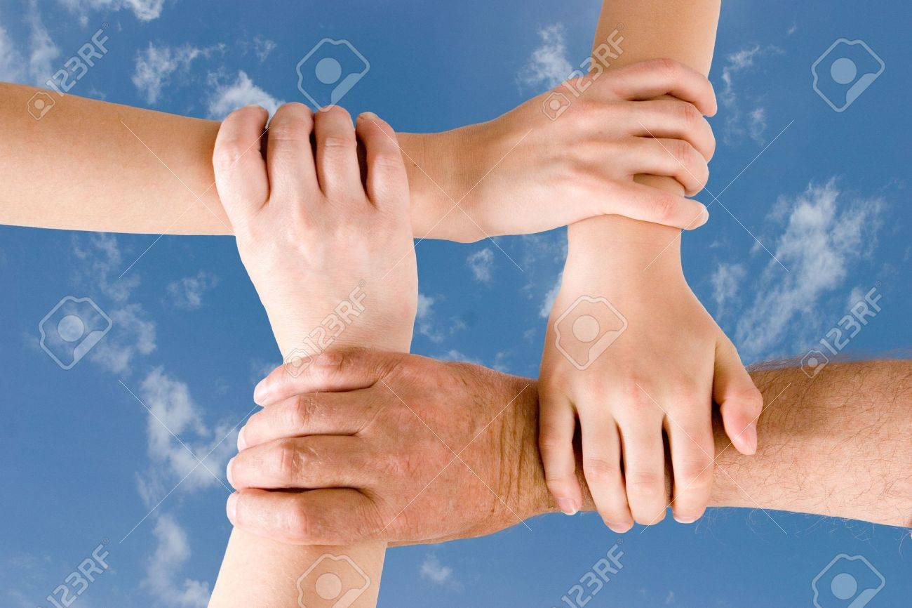 Four hands joined together Stock Photo - 963409