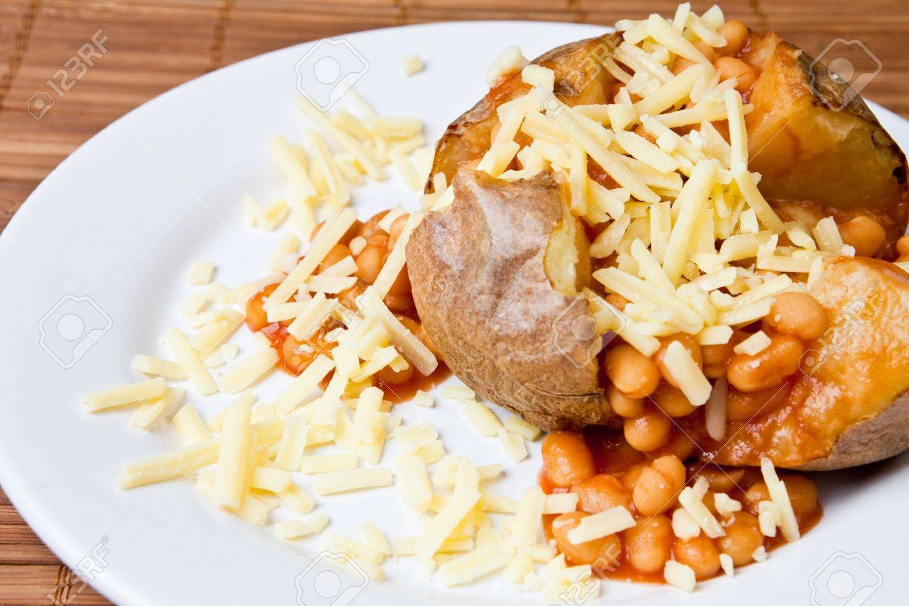 Hot and crispy baked potato stuffed with baked beans and cheddar cheese Stock Photo - 4153713