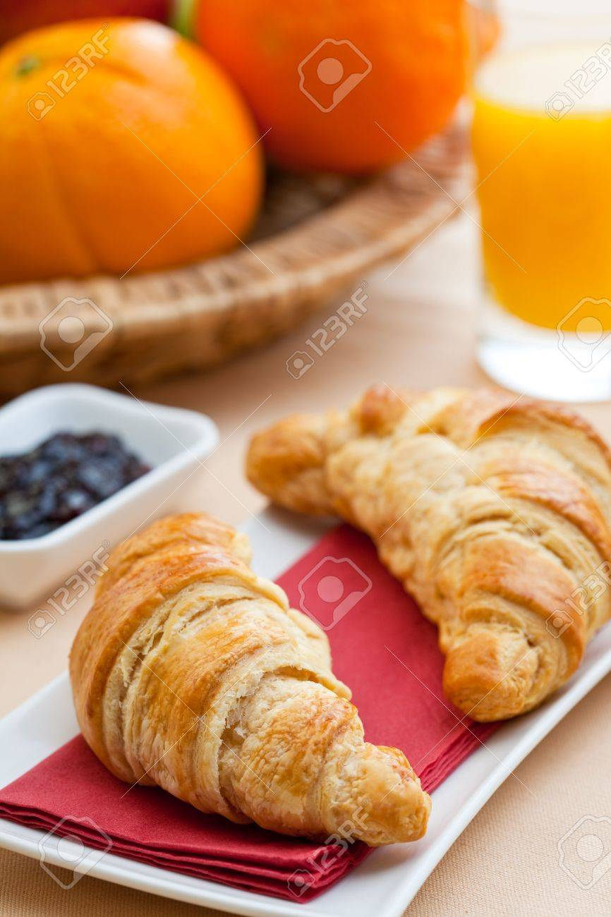 Continental breakfast with croissant, jam, coffee and orange juice Stock Photo - 5080620