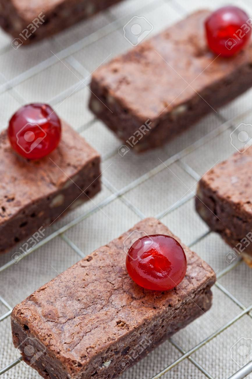 Freshly baked brownies with glac� cherries on a cooling tray Stock Photo - 6575970