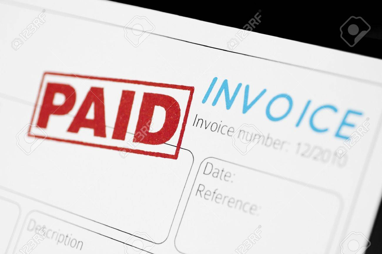 Closeup Picture Of An Invoice With Red Paid Stamp Stock Photo - Invoice stamp