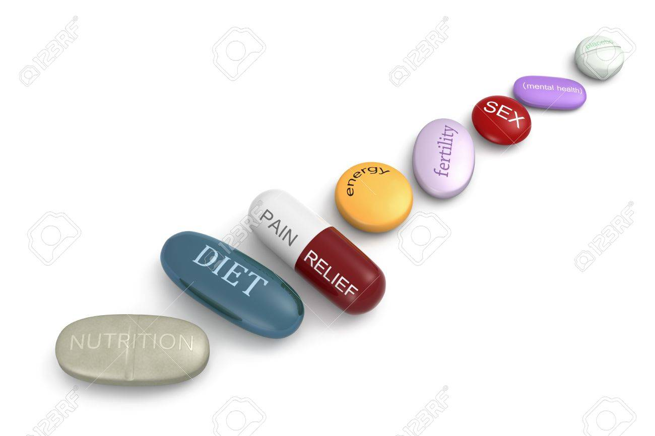 An assortment of pills with various inscriptions and colors. Stock Photo - 10982590