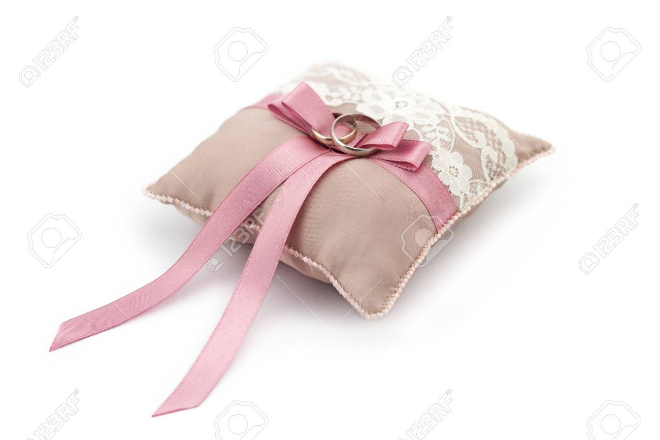 White Golden Wedding Rings On Decorated Little Pillow With Pink ...
