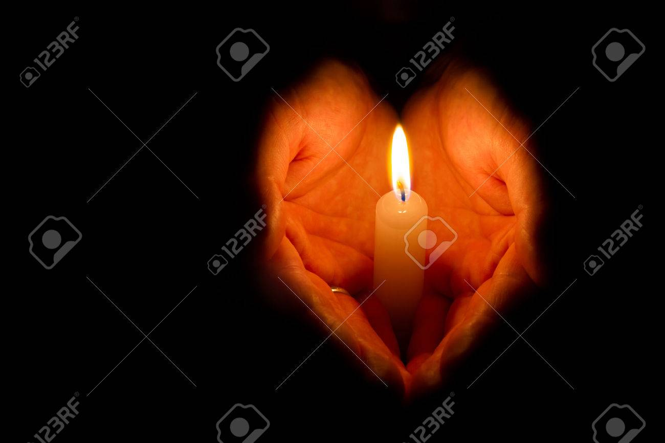 Man Hands Holding A Burning Candle On Dark Background Stock Photo ... for Holding Candle In The Dark  289hul
