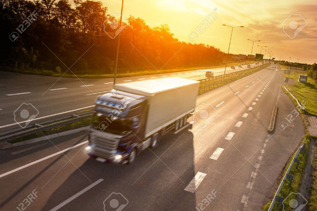 Blue truck in motion blur on the highway at sunset Stock Photo - 29382459