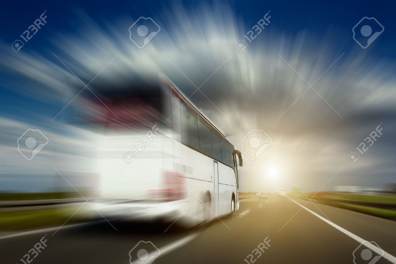 White bus in blurred motion at full speed performs overtaking on the highway. Photographed from the car when driving. Stock Photo - 42145765
