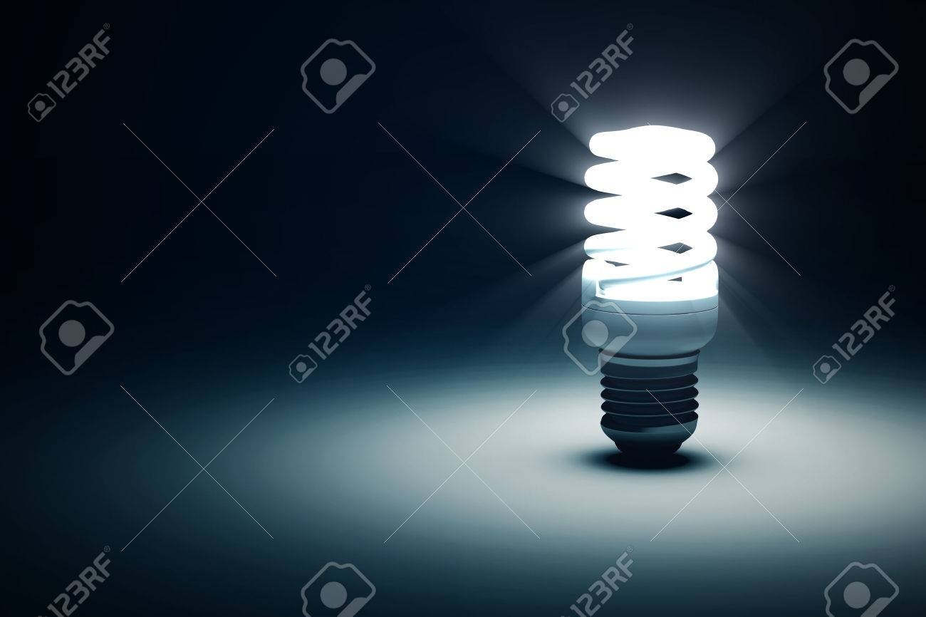 Illuminated Fluorescent Light Bulb On Blue Dark Background With ...