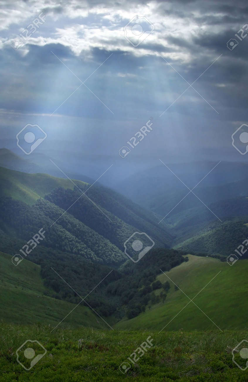 Mountain valley lightened by bright sunrays - 1828159