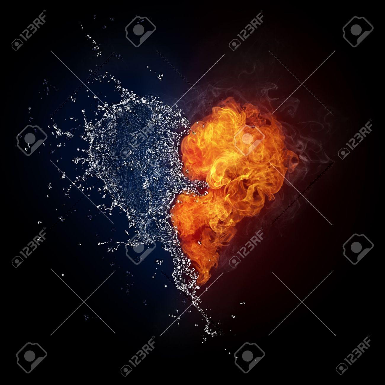 火と水の黒の背景に分離での心。...