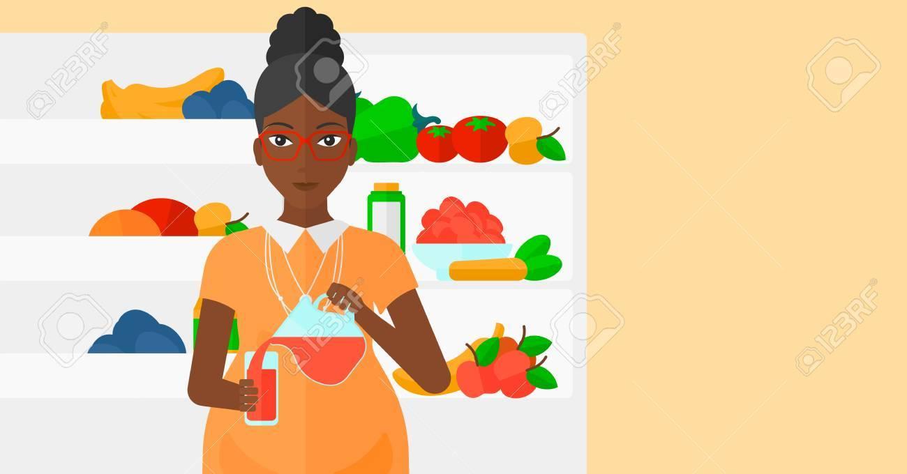Amerikanischer Kühlschrank Flach : Ein afroamerikanischer schwangeren frau saft in einem glas auf dem