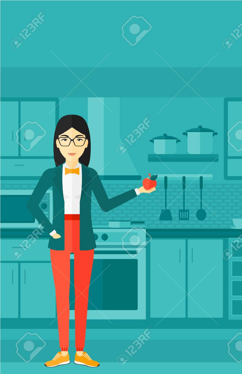 An Asian Woman Standing In The Kitchen And Holding An Apple In ...