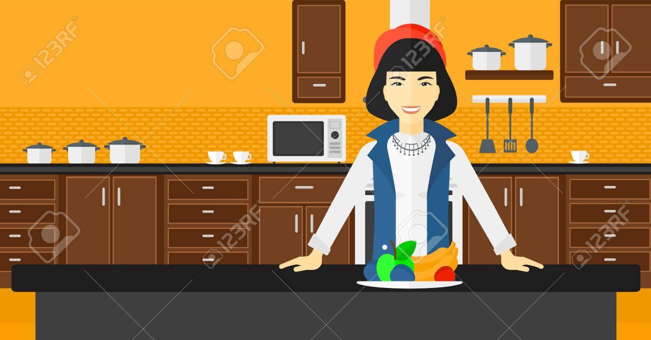 Una Mujer Asiática De Pie En La Cocina Frente A La Mesa Llena De ...