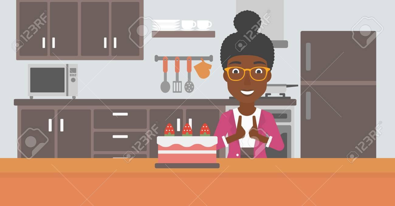 Una Mujer Afroamericana De Pie En La Cocina Y Mirando Con Pasión En ...