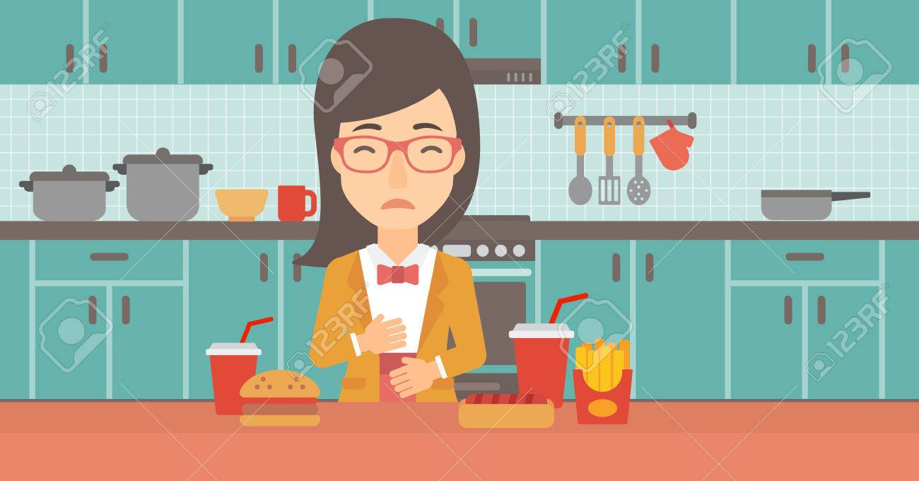 A Woman Standing In The Kitchen In Front Of Table Full Of Junk ...