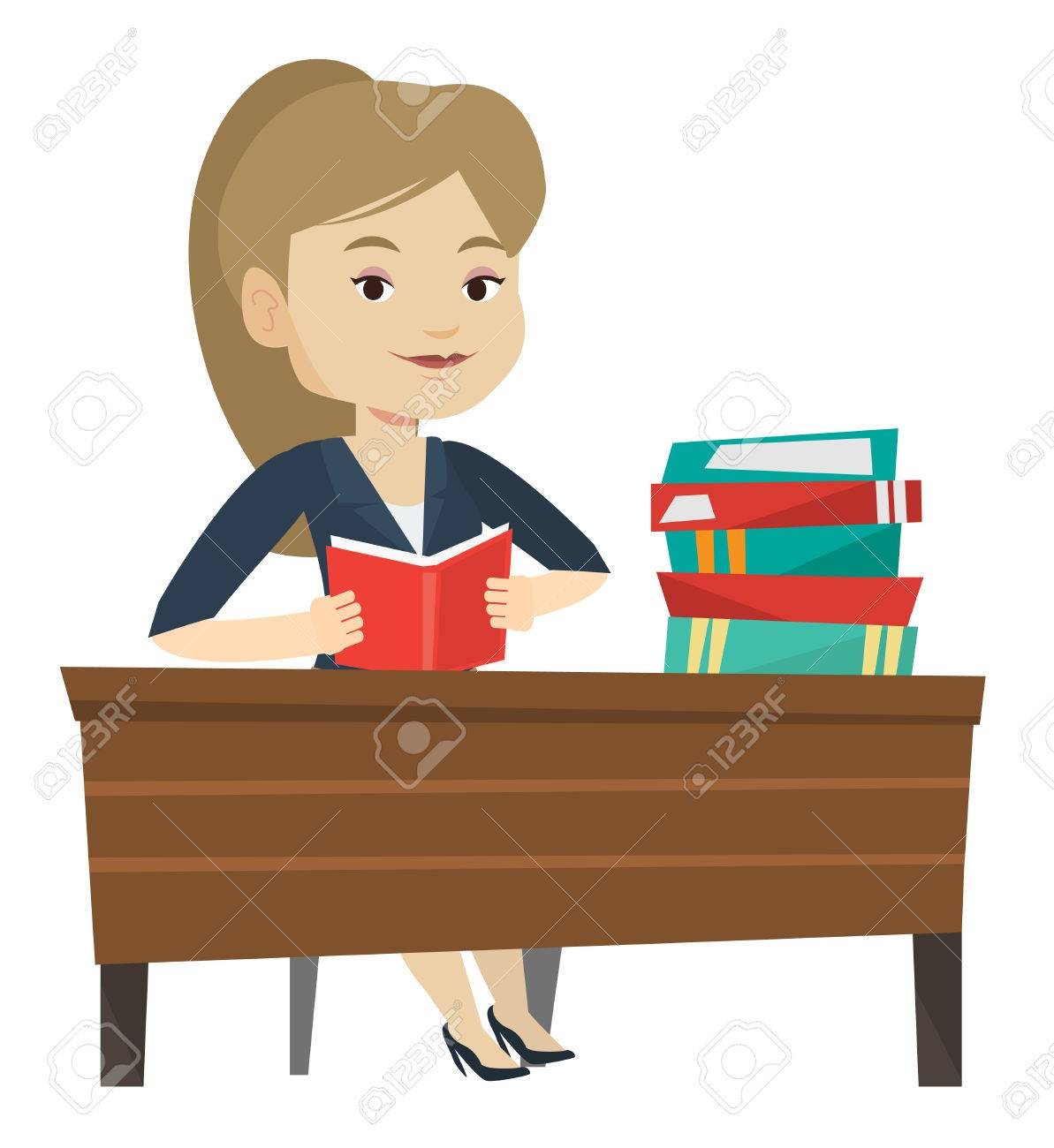 Student Sitting At The Table And Holding A Book In Hands. Smiling Student  Reading A