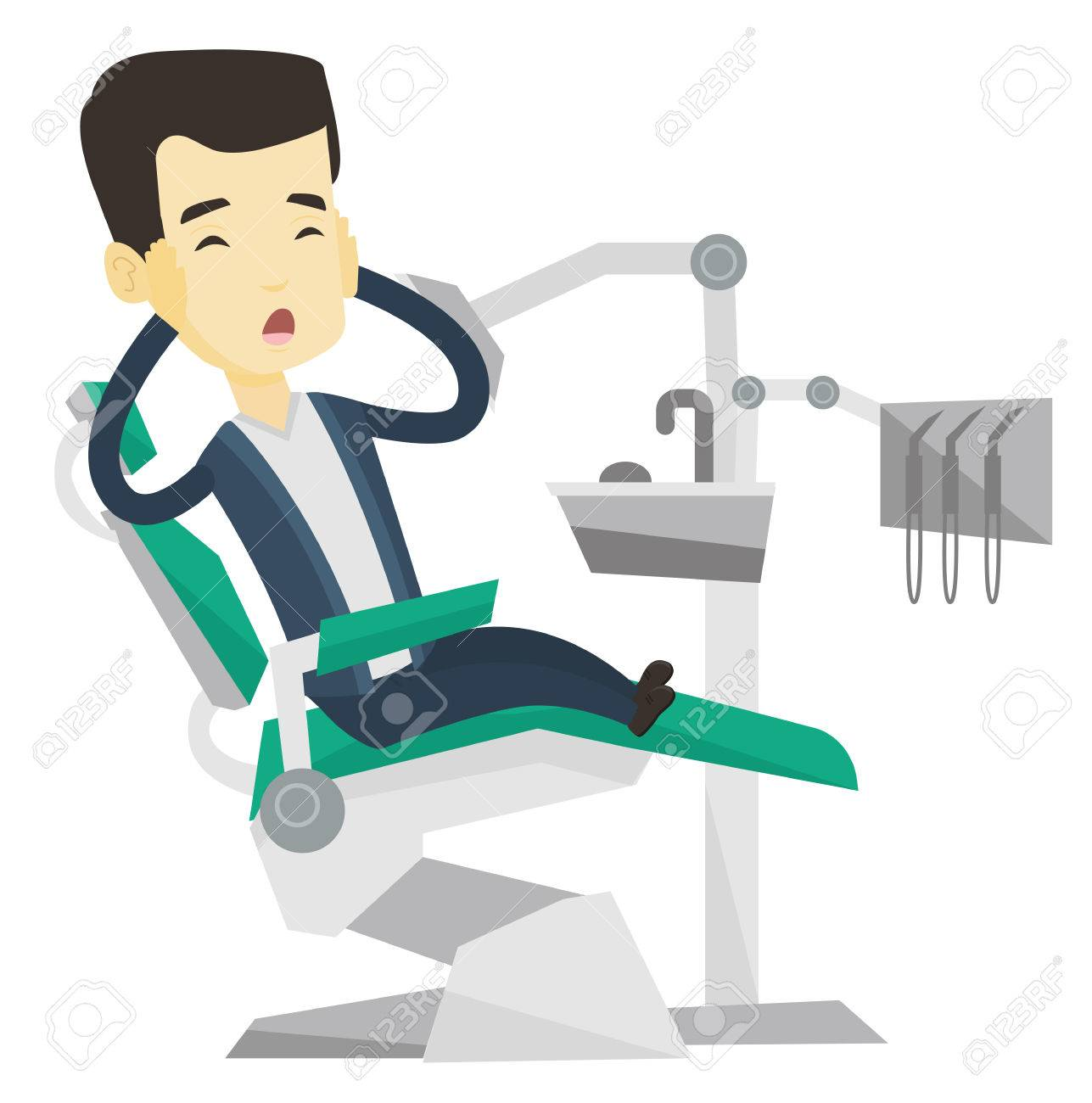 Frightened Asian Patient Sitting In Dentist Office Scared Young Man Visiting Dental Clinic