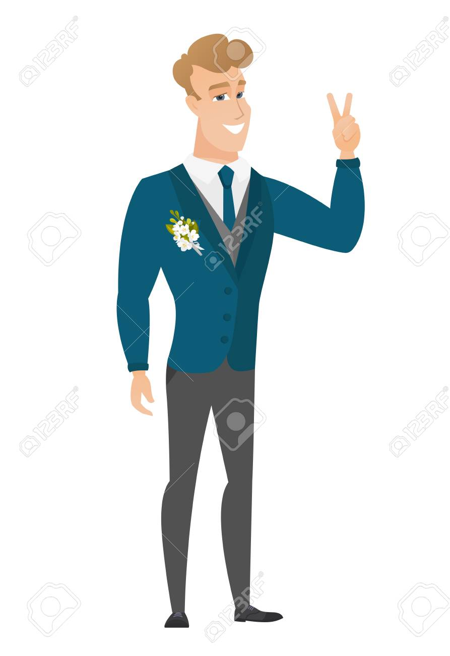 Caucasian Groom In A Wedding Suit Showing The Victory Gesture ...