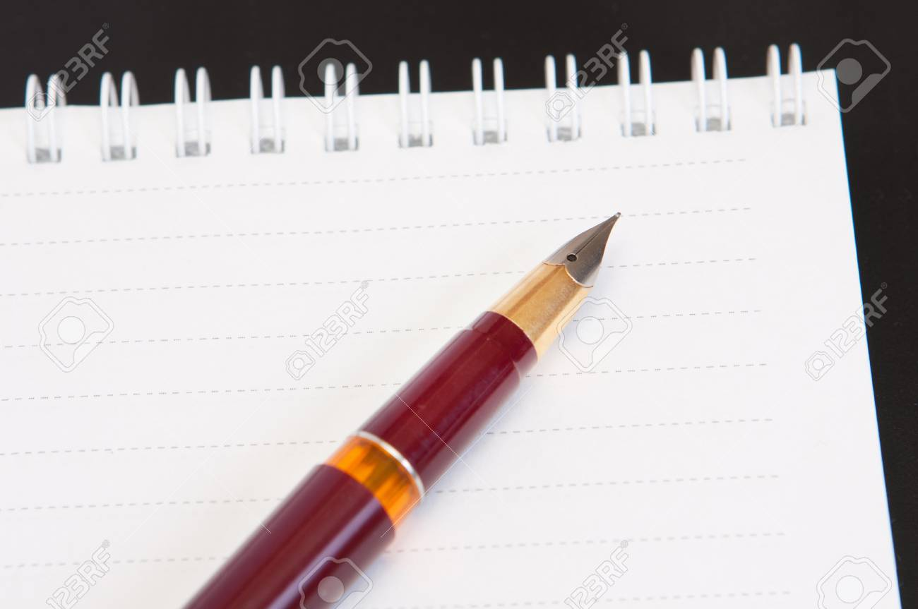Pen and notebook Stock Photo - 12056617