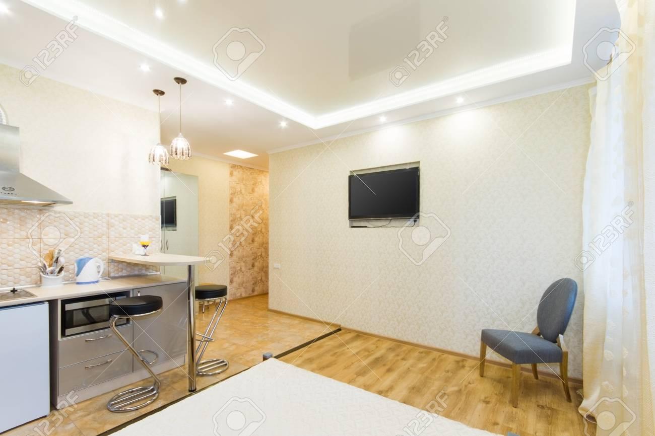 Modern studio apartment küche und wohnzimmer interior design mit
