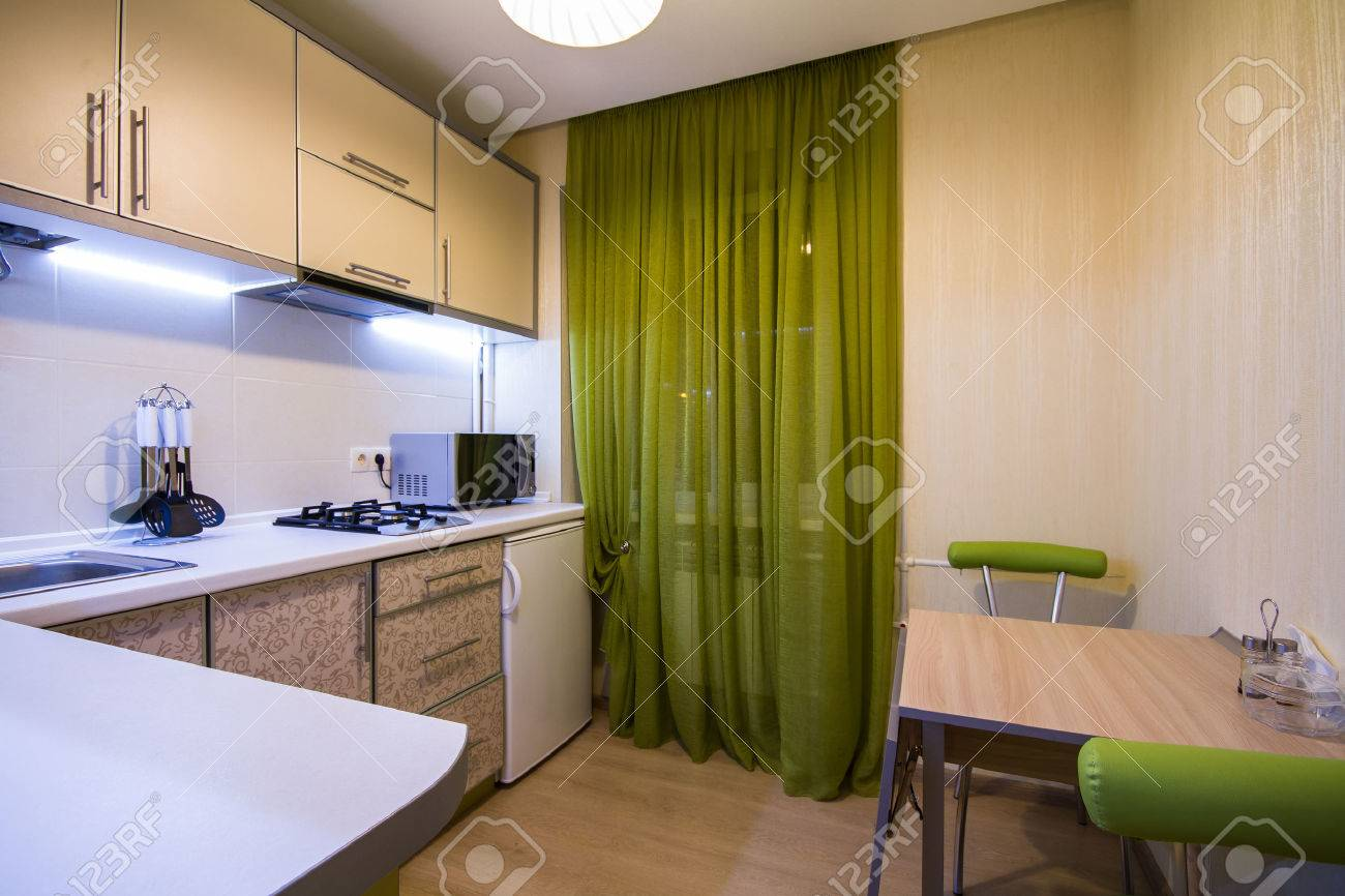 Modern Small Kitchen With Green Curtains And Led Backlight Stock Photo Picture And Royalty Free Image Image 42769509