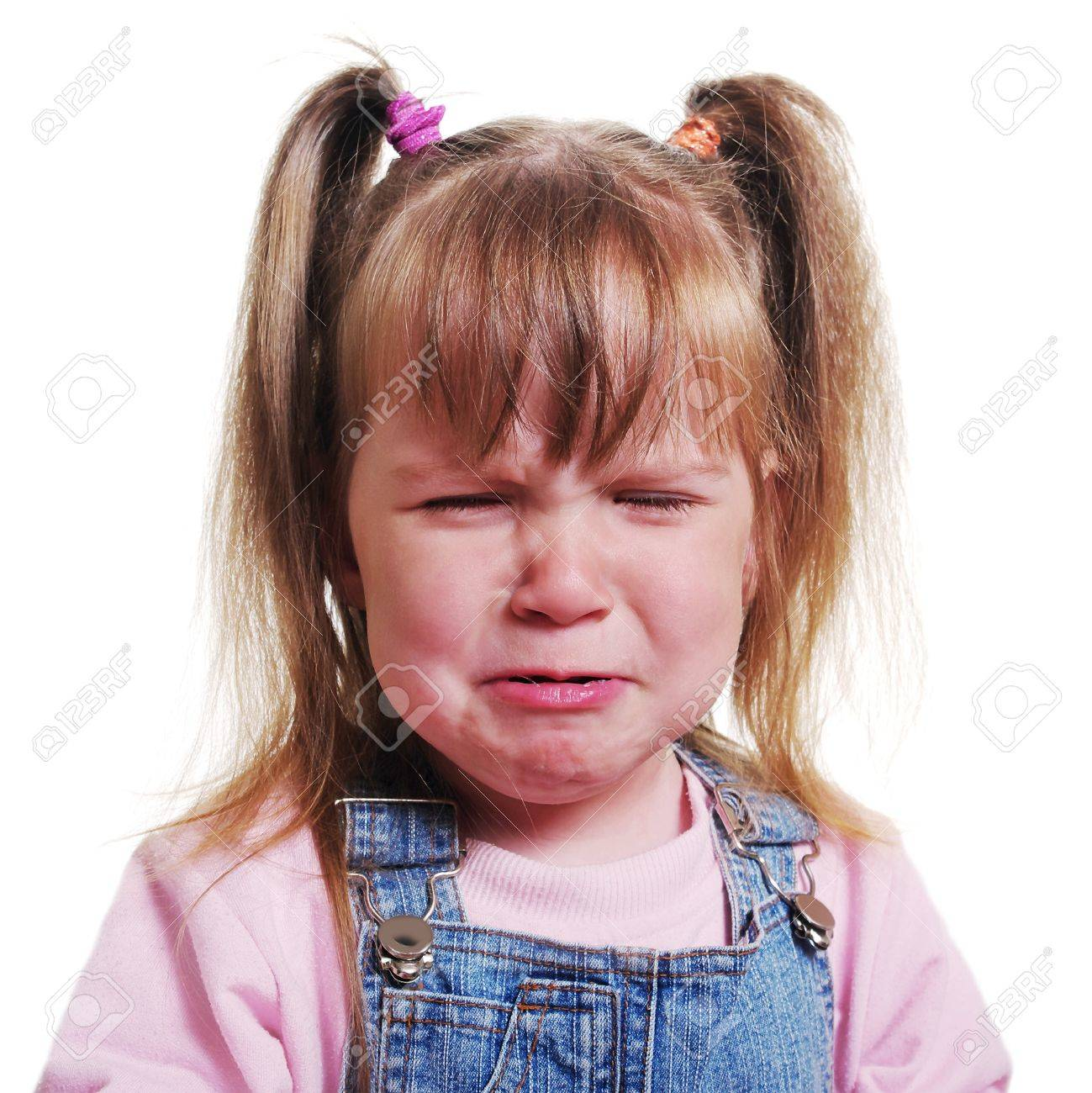 Girl with pigtail is crying. - 9819047
