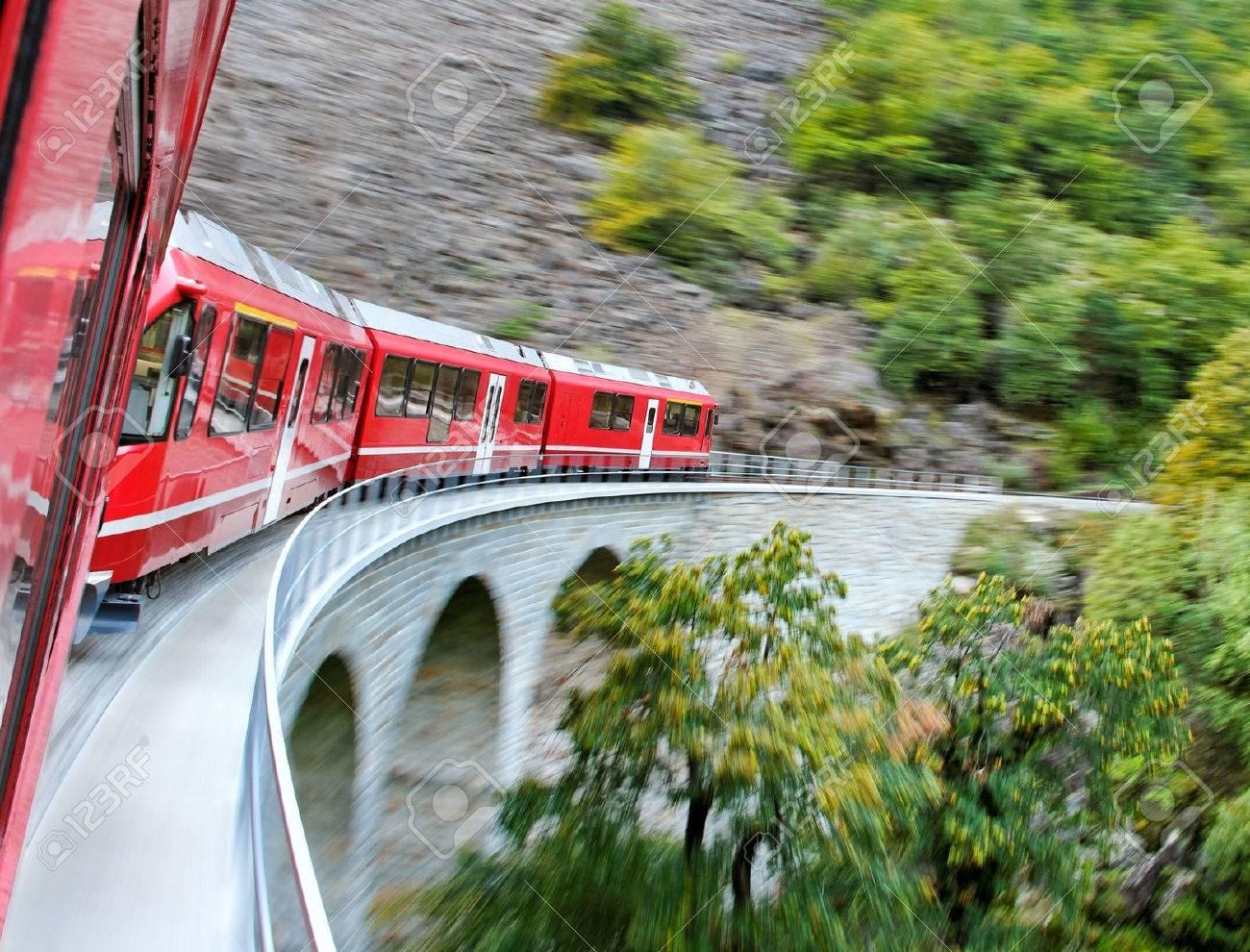 Red train from Tirano to the Switzerland. - 22607440