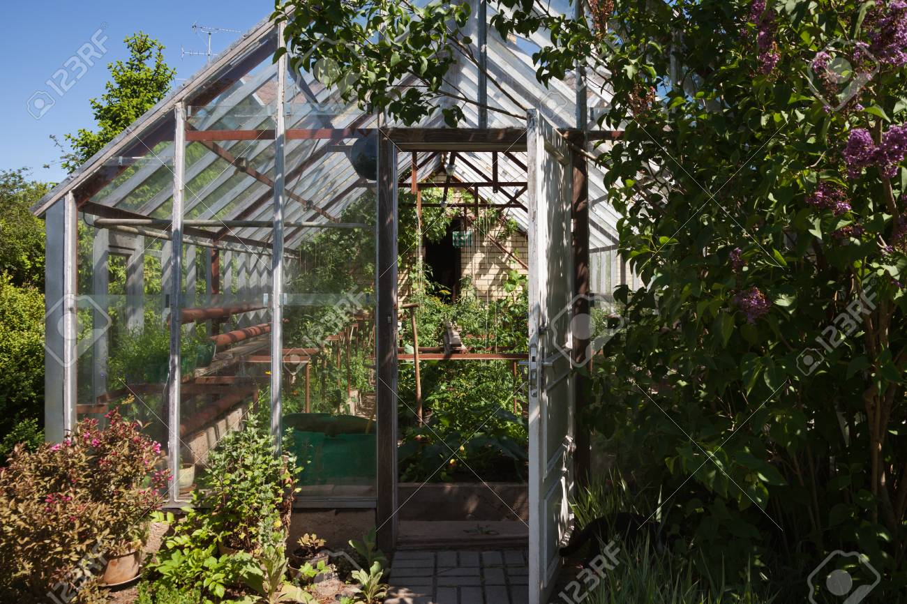 Wondrous Natural Small Garden Greenhouse In A Countryside Home Interior And Landscaping Ologienasavecom