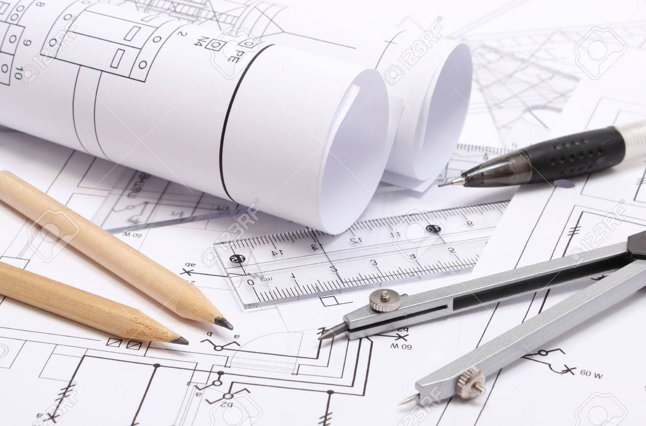 rolled electrical diagrams and accessories for drawing lying on construction drawing of house stock po