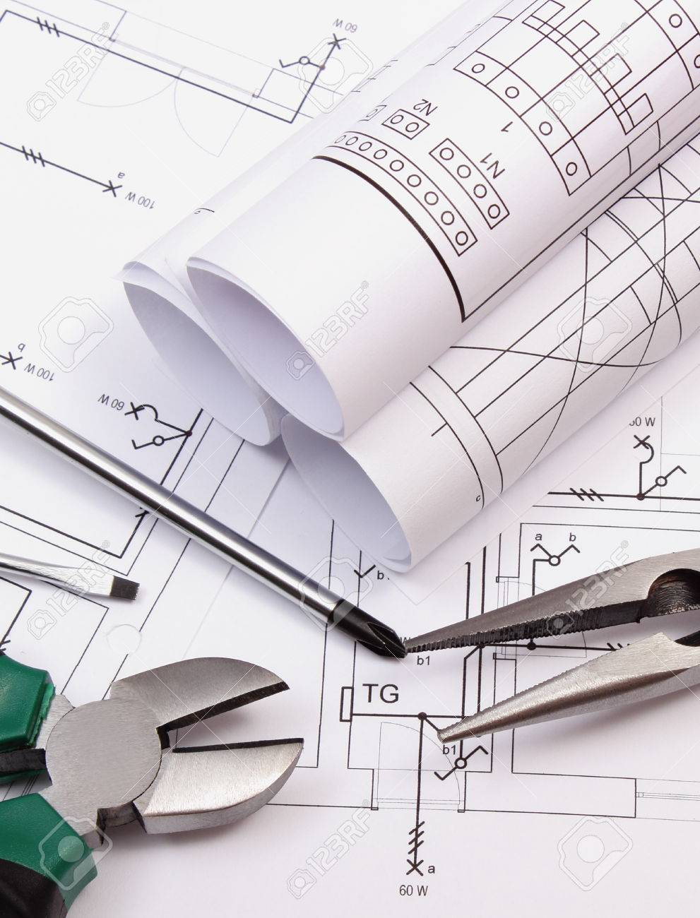 Rolls Of Diagrams Metal Pliers And Screwdriver On Electrical Engineering Construction Drawing House Work