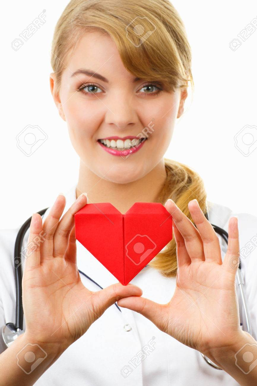 White apron health - Smiling Woman Doctor Cardiologist In White Apron With Stethoscope Holding Red Heart Of Paper Healthcare